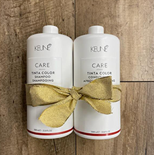 Image of shampoo and conditioner liters tied with a gold bow