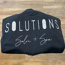 Image of black t-shirt with silver letters